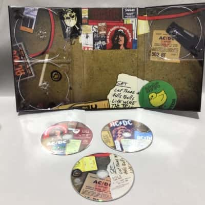 """AC/DC BOX SET """"PLUG ME IN"""" COLLECTORS EDITION 3 DVD SET Includes large poster and memorabilia"""