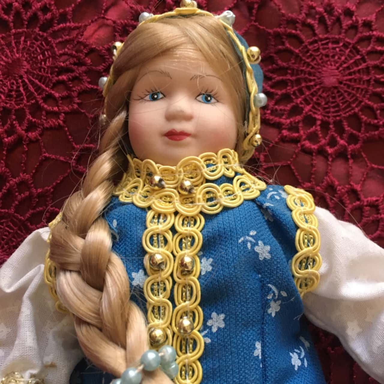 Porcelain Doll in Traditional Costume and Festive Dress from Russia