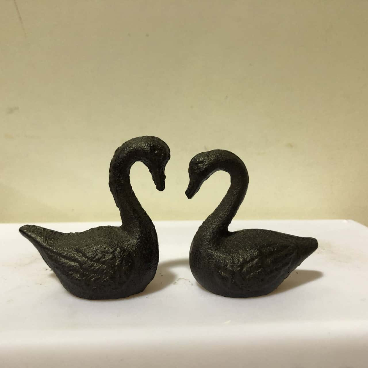 2 small Metal Swans