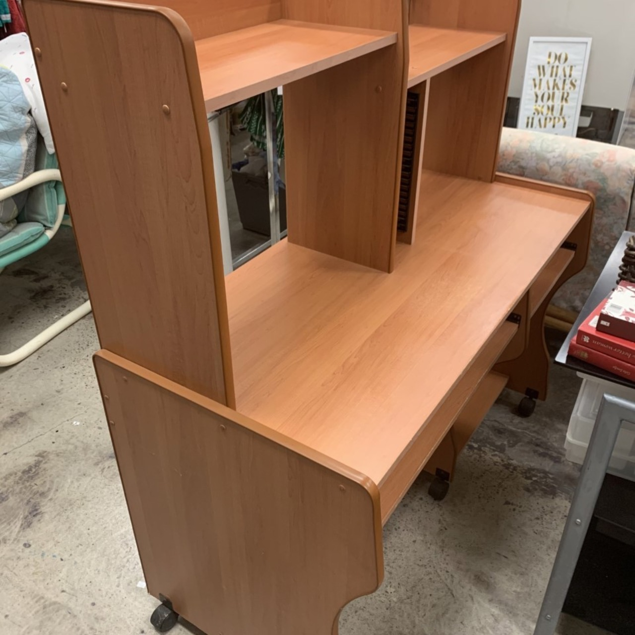 Brown wooden pullout desk with shelving