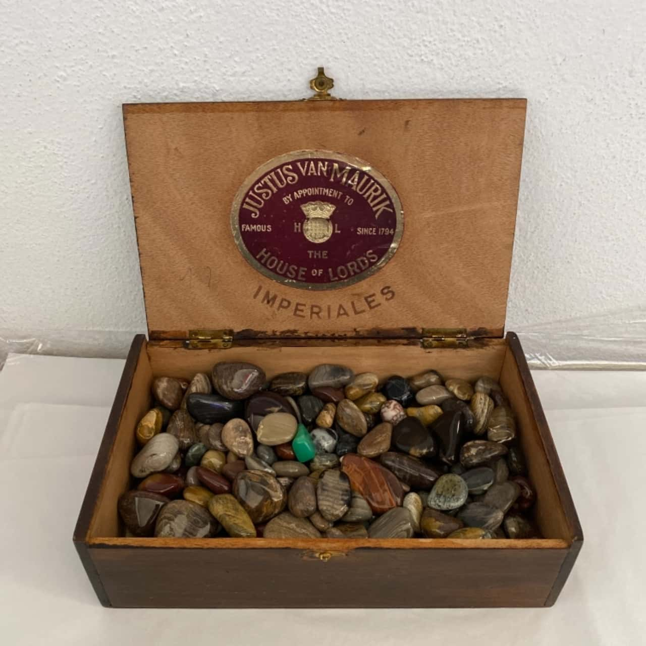 Vintage Cigar box with variety of stones inside