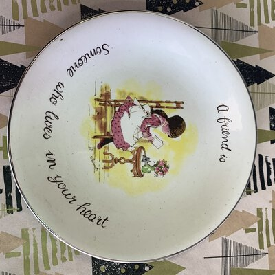 """Antique looking display plate, imagery of young girl Reading, """" A friend is someone who lives in your heart"""""""